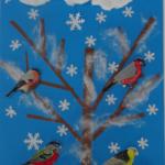 praca uczniowska o dokarmianiu ptaków